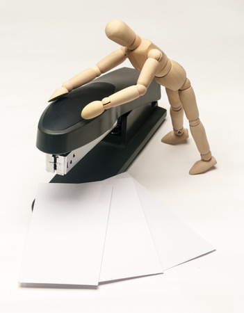Toy with white cards on stapler