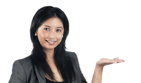 Asian woman holding up her hand