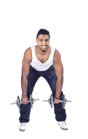 In Indian male in the studio with dumbbells against a white background photo
