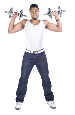 In Indian male in the studio with dumbbells against a white background