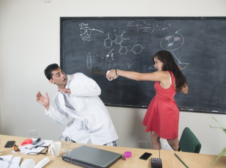 An image of a sceintist or teacher interacting with a listerner Stock Photo
