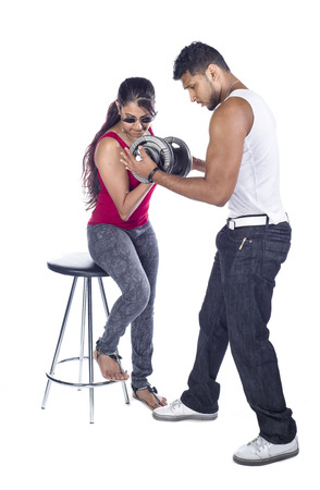 In Indian couple in the studio against a white  photo