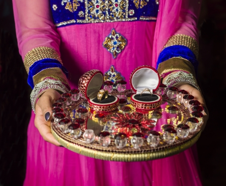 An image of a girl bringing up the wedding rings