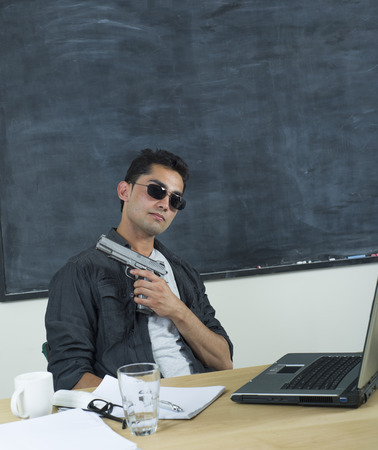An image of a young Indian man in an office or classroom photo