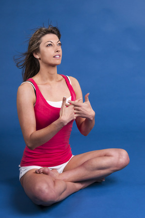 An image of a blonde Caucasian fit woman against a blue background photo