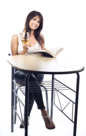An image of a cute Caucasian girl sitting behind a table Stock Photo - 26222503