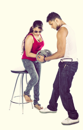 In Indian couple in the studio against a white background photo