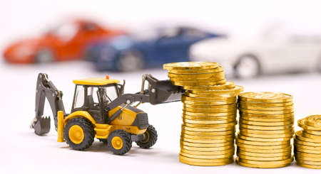 excavator and gold coins