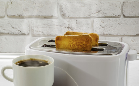 a cup of coffee and toast in a toaster2 Archivio Fotografico