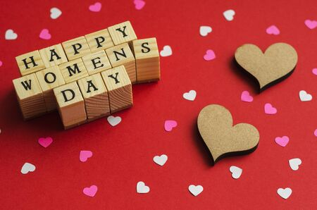 happy womens day folded from wooden cubes with letters 6