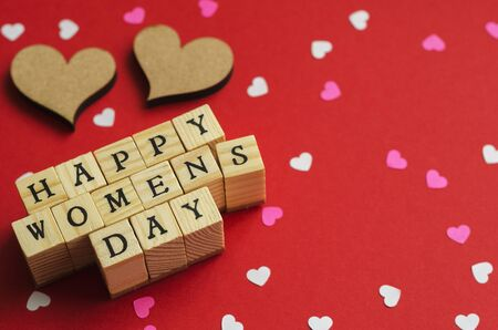 happy womens day folded from wooden cubes with letters 8