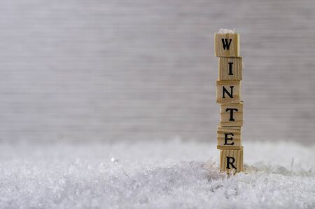 the word winter made of letters on wooden cubes on a snow background  5 Stock Photo