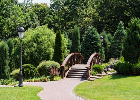 landscape design. Decorative bridge and plants
