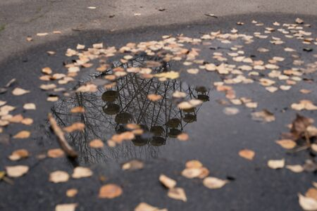 Reflection in a puddle in the Ferris Wheel in the city, the ghost of Pripyat in Chernobyl
