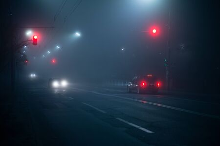 Highway road at night in the fog in the city