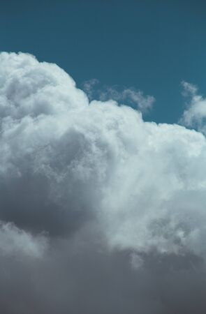 Fluffy clouds cover the summer blue sky Stock fotó