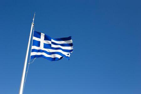 Greece flag flies against the sky Standard-Bild