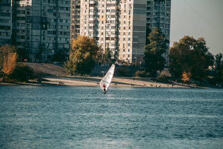 Windsurfing on the lake in Autumn