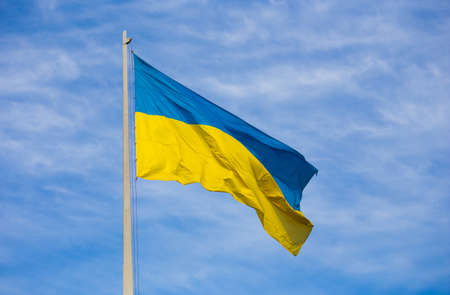 National flag of independent Ukraine waving in the wind
