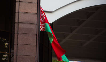 Red-green two-color flag of belarus waving on a flagpole Foto de archivo