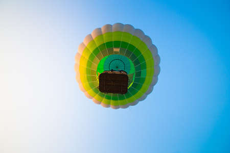 Big balloon flies against the sky
