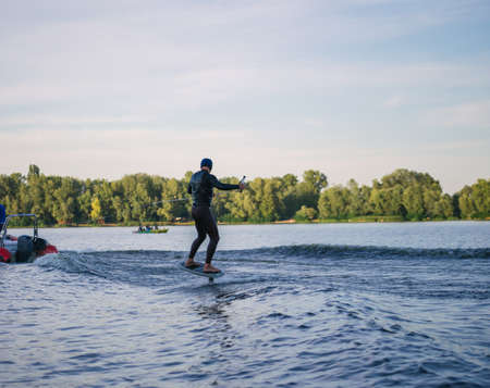 Man on a wakeboard in the river at daytime Stock Photo