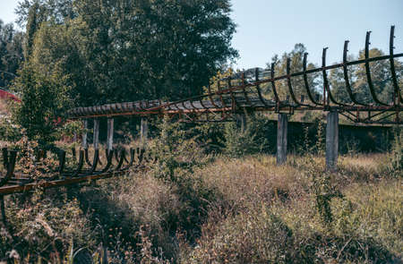 Old abandoned wooden bobsleigh track in summer by daylight Standard-Bild