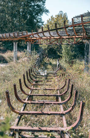 Old abandoned wooden bobsleigh track in summer by daylight Banque d'images