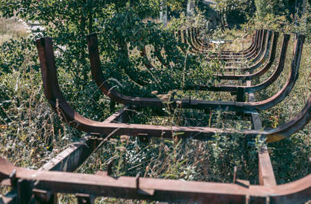 Old abandoned wooden bobsleigh track in summer by daylight