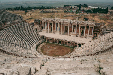 Ancient Roman amphitheater made of stone under the open sky in Pamukkale in Turkey