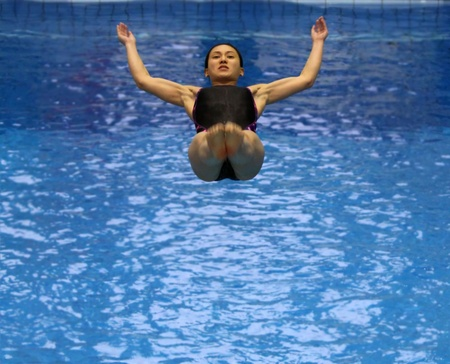 Rostock, Germany - MAY 29, 2011 - Malaysian sportswoman Leong Mun Yee during a warming up jump at the 56th International Divers Day