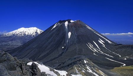 maori: Active Volcanos Mount Ngauruhoe and Ruapehu (Tongariro N.P., New Zealand) Stock Photo