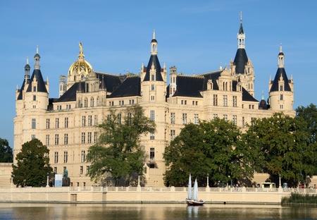 bundesgartenschau: Sailing boat in front of the old castle of Schwerin (Germany)