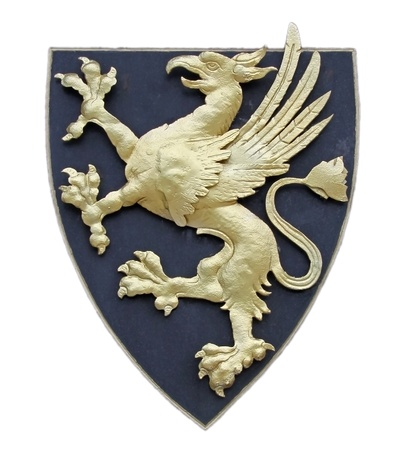 Griffin as a symbol for a coat of arms, isolated on white background