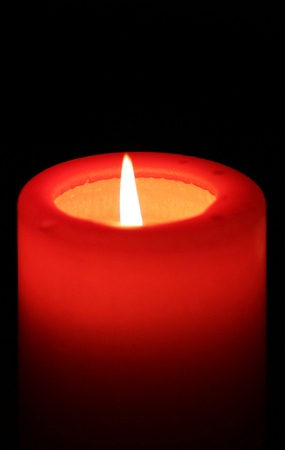 red candle with black background  photo