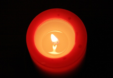 abstruse: red candle with black background (view from top)