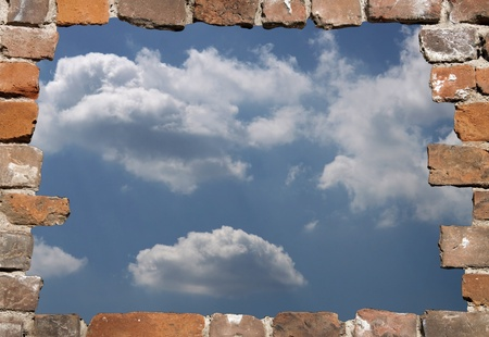 abstruse: Old brick wall as a grungy frame with sunny heaven