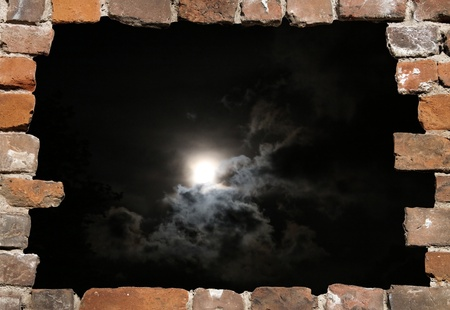 abstruse: Old brick wall as a grungy frame with night heaven