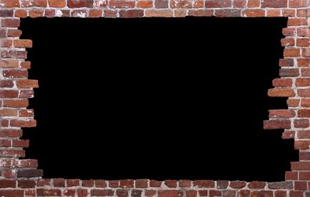 freigestellt: Old brick wall as a grungy frame, isolated on black background in the centre