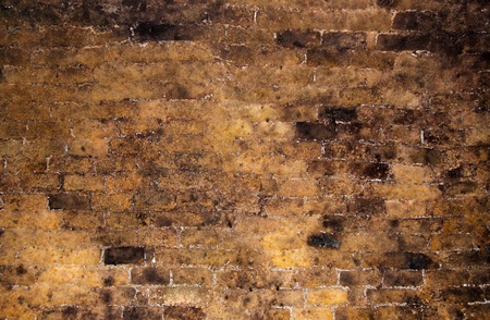 Brick wall inside of an old wine cellar as background photo