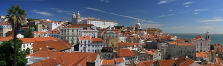 Lisbon panorama from old quarter with colorful houses  photo