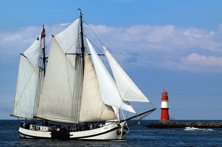 PORT WARNEMÜNDE, GERMANY - AUGUST 13: Cruise of an old Sailing ship on August 13, 2011 during the 21st annual Hanse-Sail event in Port Warnemunde, Germany 02
