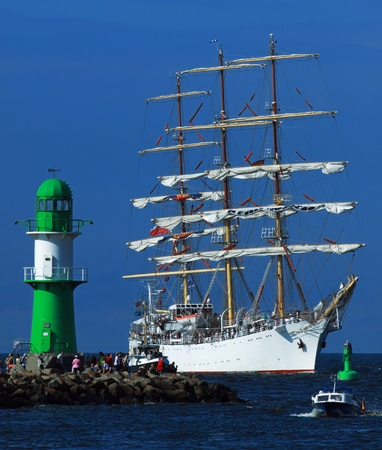 yachtsman: PORT WARNEM�NDE, GERMANY - AUGUST 13: Cruise of an old Sailing ship on August 13, 2011 during the 21st annual Hanse-Sail event in Port Warnemunde, Germany