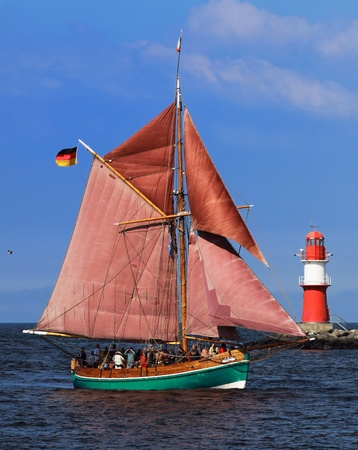 yachtsman: PORT WARNEM�NDE, GERMANY - AUGUST 13: Cruise of an old Sailing ship on August 13, 2011 during the 21st annual Hanse-Sail event in Port Warnemunde, Germany 04