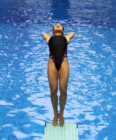 neptun: ROSTOCK, GERMANY - MAY 29: Leong Mun Yee (MAS) during a warming up jump on May 29, 2011 in the scope of the 56th International Divers Day at the site of the Neptun swimming pool in Rostock, Germany.