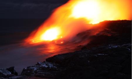 molted: Lava entry in to the ocean at night  Puhi-o-Kalaikini at Big Island, Hawaii