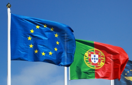 Flags of Portugal and EU in the sun photo