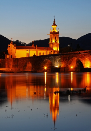 lima: Old medieval bridge and church of Ponte de Lima after sunset Stock Photo