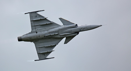 Air Force Base LAAGE, GERMANY - AUGUST 23: Saab JAS 39 Gripen jet during flight demonstration on 23   August, 2014 during the German Air Force Open Day at Tactical Air Force Wing 73 Steinhoff, Germany  02
