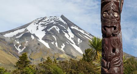 egmont: Maori statue in front of Volcano Taranaki New Zealand